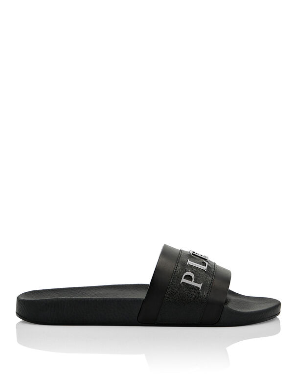 Flat gummy and leather slippers
